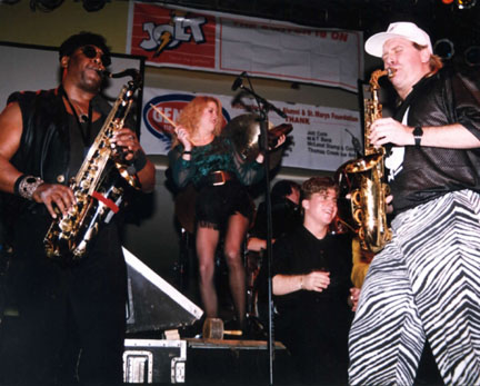 "Clarence Clemmons, Greg Straka - Clarence Clemmons and Jason Hervey perform with Nik. That's Tam Pinegar on the cowbell (""more cowbell please"") and Greg Straka (sax, right)."