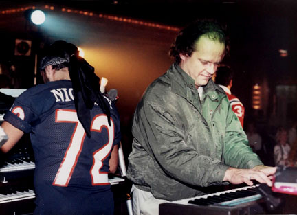 Kelsey Grammar - Kelsey Grammar plays keyboards with Nik & the Nice Guys at a Chicago Blackhawks Holiday Party.